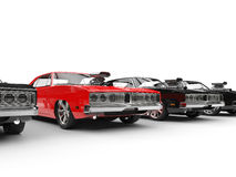 Row of muscle cars - focus on red car Stock Photography