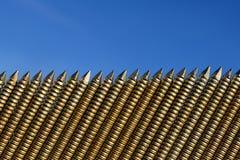 A row of nails. Ribbed nails for a nail gun Stock Photos