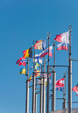 Row of national flags against blue sky Royalty Free Stock Image