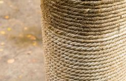Row of natural beige rope horizontal row wound on a log close-up a column with jute on a blurry ground background royalty free stock photography