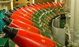 Row of naval artillery shells for deck gun Stock Image