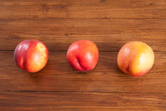 Row of nectarines on wood Stock Photography