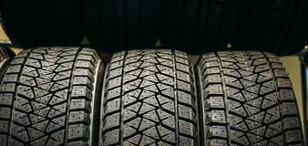 Row of new black clean rubber car tires in store. Close up royalty free stock photos