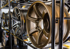 Row of new car alloy rim. Royalty Free Stock Photo