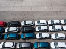 Row of new cars. Waiting to be shipped overseas on a parking Stock Images