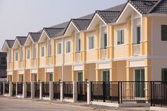 A row of new and colorful townhouses Stock Images