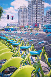 Row of new green public sharing bicycle lined up on the street. Modern concept of ecological transportation, Bike urban transport Royalty Free Stock Photo