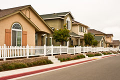 Row of New Houses. A row of newly constructed detached houses in a planned community Stock Images