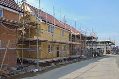 Row of new houses under construction. Row of new estate  houses under construction Stock Photo