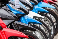 Row of new motorbikes for sale. Row of new motorbikes sale Stock Images