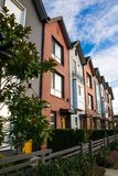 A row of new real estate townhouses or condominiums. A row new real estate townhouses or condominiums Royalty Free Stock Images