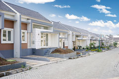 Row of the new residential. Image of a row of the new residential in construction with empty road Stock Images