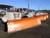 Row of new snow plows stock photo