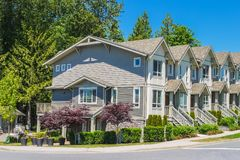 Row of new townhouses with side entrance from the street. Row of new townhouses with side entrance from the street royalty free stock photo