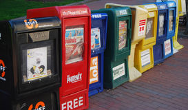 Row of newspaper boxes on the street. In Boston, capital city of United States of America Stock Photo