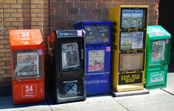 Row of newspaper boxes on the street Royalty Free Stock Photos