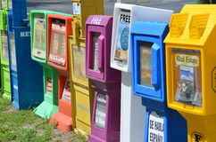 Row of newspaper vending machines. Newspaper racks for free real estate magazines at the Overseas Highway / Highway1 in Key Largo, Florida Stock Photos