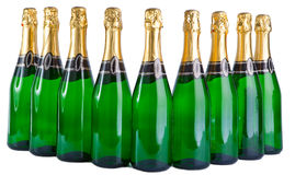 A row from nine glass green bottles Royalty Free Stock Photos