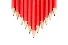 Row of Red Pencils in an Arrow Shape. Row of normal red colored lead pencils shaped into an arrow Royalty Free Stock Images