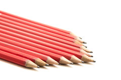 Row of Red Pencils in an Arrow Shape. Row of normal red colored lead pencils shaped into an arrow Royalty Free Stock Photography