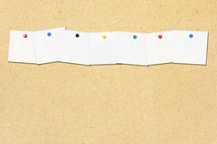 Row of note paper note on cork board Royalty Free Stock Photos