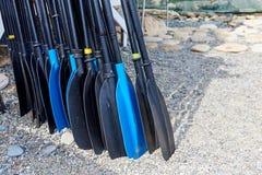 A row of oars on the beach. Close up stock photos