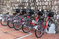 Row Of Electric Bicycles In The Parking Lot Stock Photos