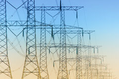 Free Row Of Electricity Pylons Stock Photography - 21716972