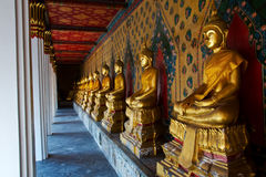 Row Of Golden Buddha Statue At Temple Stock Photo