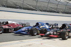 Row Of IRL Open Wheel Racing Cars On Pit Row Royalty Free Stock Photography
