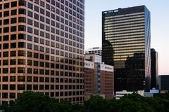 Free Row Of Modern Office Buildings Reflecting Sunset Above A City Park In Downtown Los Angeles Stock Photos - 165056873