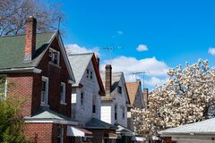 Free Row Of Old Wood Homes In Woodside Queens New York Next To A Flowering Tree During Spring Royalty Free Stock Photography - 184535917