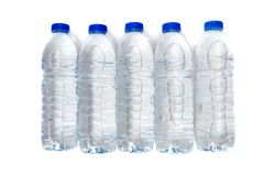 Row Of Plastic Water Bottles Isolated On A White Background. Stock Photo