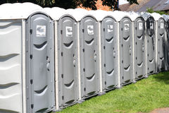 Free Row Of Portable Outside Toilets. Royalty Free Stock Images - 25802349