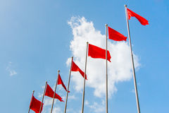 Free Row Of Red Flag In Front Of Blu Sky Royalty Free Stock Photos - 75823768