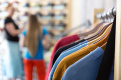 Free Row Of Summer Seasonal Apparel And Customers In Retail Shop Stock Photo - 88320090