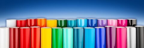 Free Row Of Various Rainbow Colored Vinyl Car Wrapping Or Plotter Cutting Sticker Foil Film Rolls  Blue White Wide Panorama Banner Royalty Free Stock Photos - 174790558