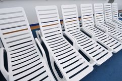Row Of White Beach Chairs Royalty Free Stock Photos