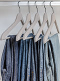 Row ofjeans on hangers Stock Photography