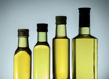 Row of oil in bottles Stock Image