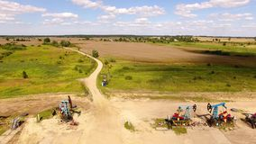 The row of oil derricks. Aerial view of the row of oil derricks in summer stock footage