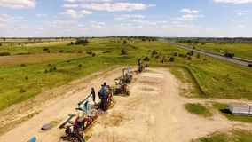 The row of oil derricks. Aerial view of the row of oil derricks in summer stock video footage