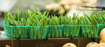 A row of okra. Rows of green okra lined up at a local farmers market in baskets royalty free stock photo