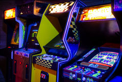 Row of Old Arcade Video Games with Shining Displays. In a Dark Gaming Room Stock Photography
