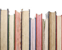 Row of old books. A close up row of books isolated against white royalty free stock photos