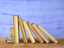 Row of old books. On blue background free copy space Royalty Free Stock Images