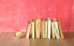Row of old books, cup of coffee, free copy space Stock Photo