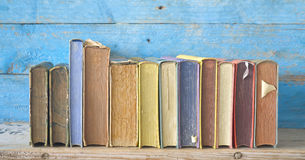 Row of old books. Grungy background, good copy space royalty free stock photography