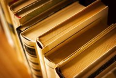 Row of old books in an office, school or library Royalty Free Stock Images