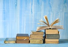 Row of old books,. One opened, free copy space Stock Photos